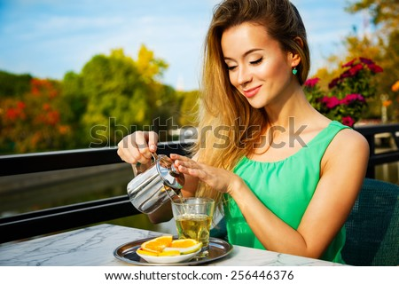Young Woman Making Green Tea Outdoors. Summer Background. Shallow Depth of Field.  - stock photo