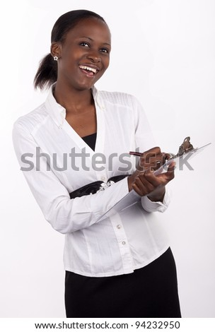 Young woman making notes with a happy expression. - stock photo