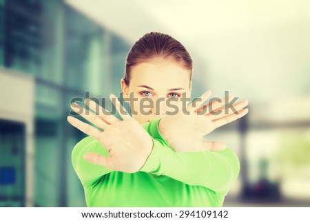 Young woman making stop sign - stock photo