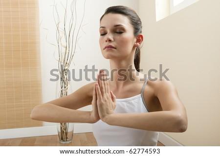 Young woman meditating, close-up - stock photo
