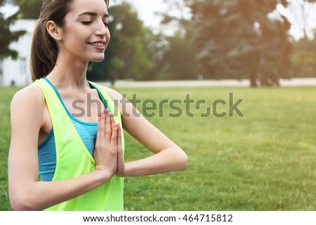 Young woman meditating in park