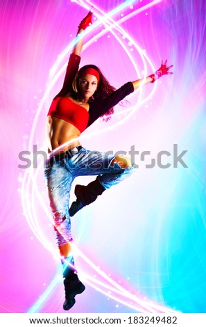 Young woman modern dance with light effects.