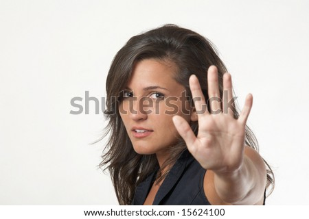Young woman motioning to stop, focus on face - stock photo