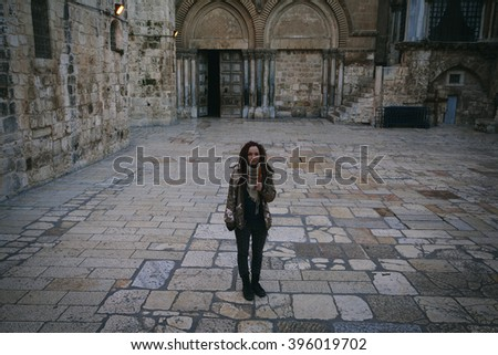 Young woman near Church of the Holy Sepulchre in Old City of Jerusalem