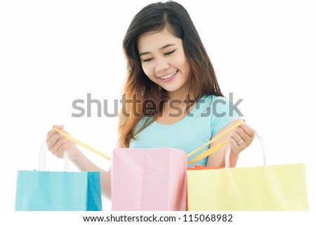 Young woman observing her purchases