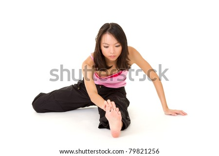 Young woman of Asian doing exercising on ground,  full length portrait isolated on white background. - stock photo