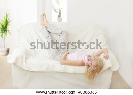 Young woman of the house on a sofa