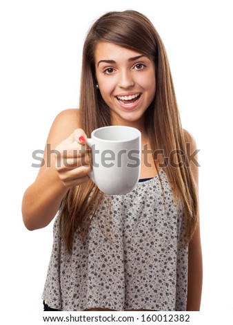 young woman offering a mug isolated on white