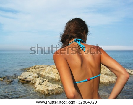 young woman on a beach in spain - stock photo