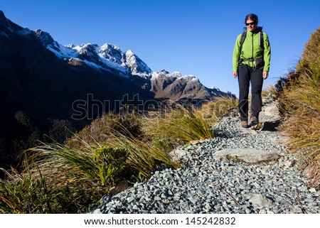 Young woman on a mountain hike - stock photo