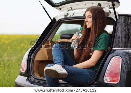 Young woman on a road trip.
