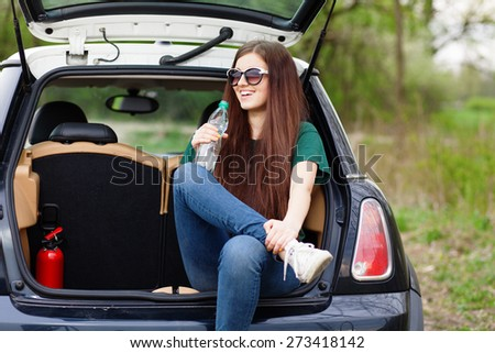 Young woman on a road trip. - stock photo