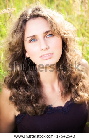 Young woman on a summer field. - stock photo