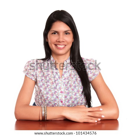 young woman on desk smiling and looking at the camera - stock photo