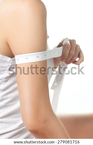 Young woman on diet measuring her fat, Beauty body care and diet - stock photo