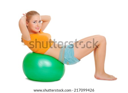 Young woman on gymnastic ball isolated - stock photo