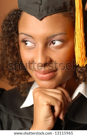 Young woman on her graduation day, calm and thoughtful - stock photo