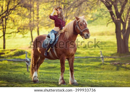 Young  Woman on Horse - Afternoon Trail Ride  - stock photo