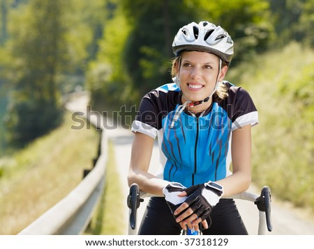 young woman on road bike. Copy space - stock photo