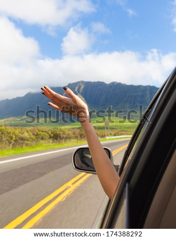 Young woman on road trip in her new car. - stock photo