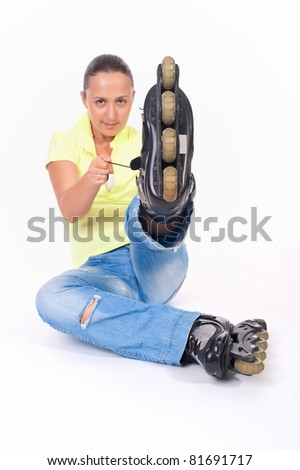 young woman on roller skates - stock photo