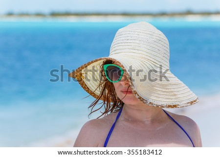 Young woman on the caribbean beach in Cuba - stock photo