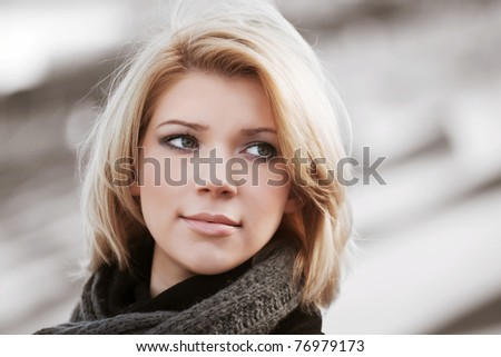 Young woman on the city street - stock photo