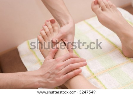 young woman on the feet therapy massage procedure