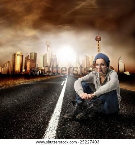 young woman on the street listen music - stock photo