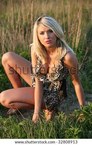 Young woman on the sundown. - stock photo