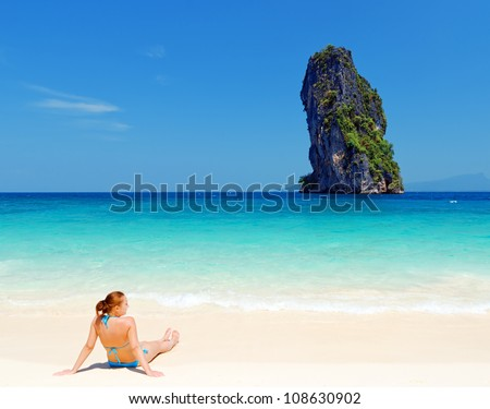Young woman on the tropical beach.