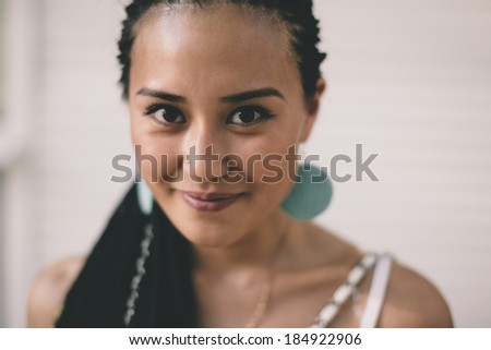 young  woman on the white wall background - stock photo