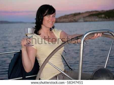 young woman on the yacht with glass of wine - stock photo