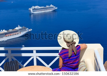 young woman on vacation in Santorini, Greece - stock photo