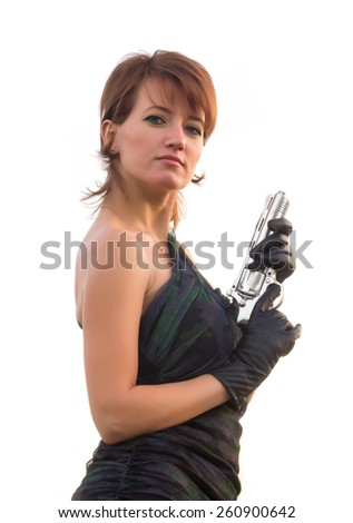 Young woman on white background holding a gun - stock photo