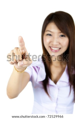 Young woman on white background is pressing on empty space - stock photo