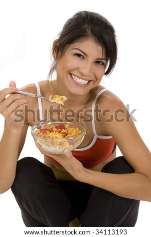Young woman on white background with a bowl of cereal - stock photo