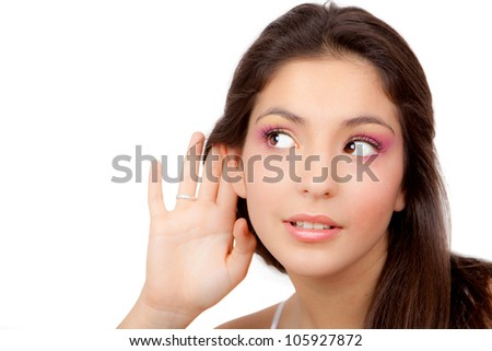 young woman or teen listening to whispers - stock photo