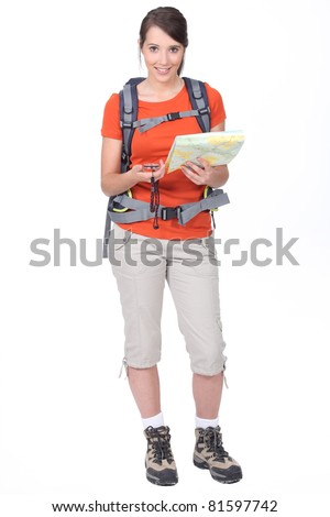 young woman orienteering - stock photo