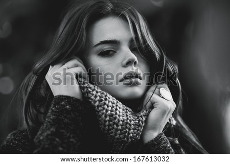 Young woman outdoors autumn portrait. Black and white colors. - stock photo