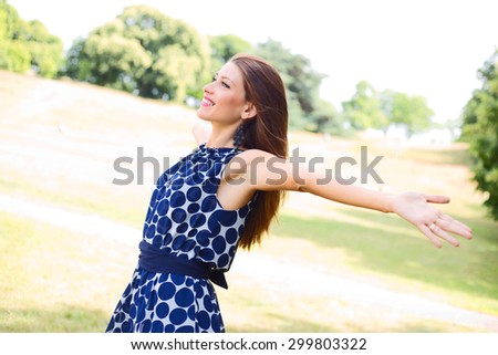 young woman outdoors enjoying the fresh air. - stock photo