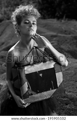 Young woman outdoors fashion portrait. Soft sunset light .B&W