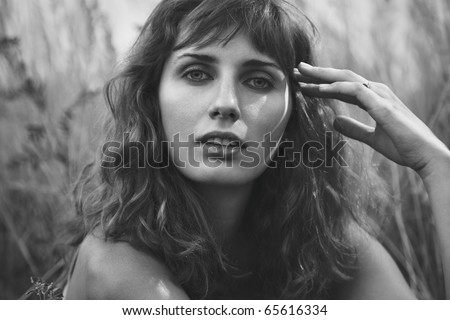 Young woman outdoors portrait. Black and white colors. - stock photo