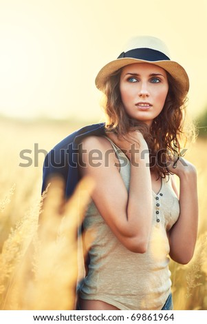Young woman outdoors portrait. Sunny colors. - stock photo