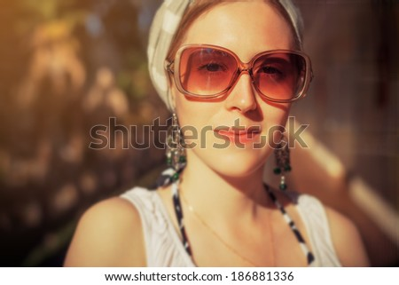 Young woman outdoors portrait. Warm colors. - stock photo