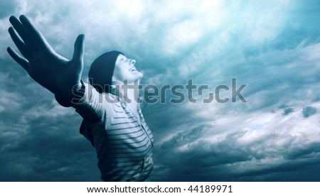 Young woman over cloudy sky. Focus on hand - stock photo