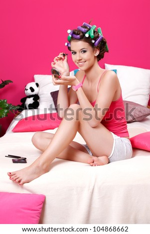 young woman painting her eyes with brush - stock photo