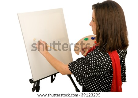 Young woman painting on a blank canvas - stock photo