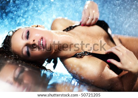 Young woman passion. Water studio photo.