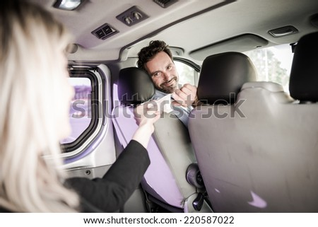 Young woman paying for the taxi - stock photo
